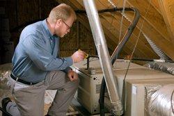 man_inspecting_furnace